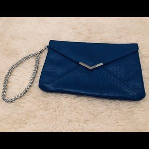 NWOT Blue clutch with silver chain and detail